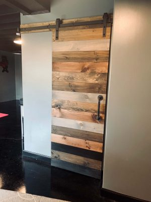 mixed stain horizontal plank barn door